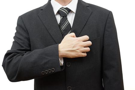 meticulous: nervous businessman filing fingernails on his suit