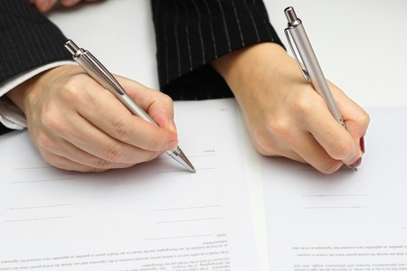 compromise: man and woman signing document or prenup