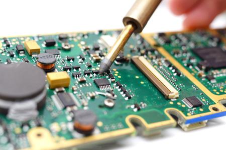 printed circuit board: Electrical Engineer is soldering on printed circuit board