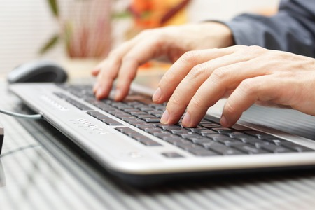 businessman  is typing on keyboard photo