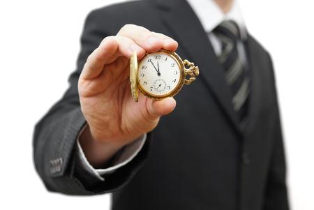 punctual: Empresario mostrando 5 minutos para las doce Foto de archivo