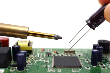 Solder the capacitor on the motherboard photo