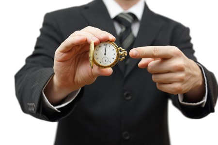 delay or late concept with businessman showing pocket watch photo
