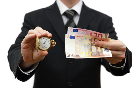 time is money concept with businessman with money and pocket watch Stock Photo