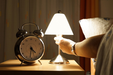 bedside lamp: get out of bed in the middle of the night Stock Photo