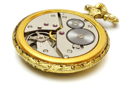 gold watch: closeup of old vintage pocket gold watch isolated