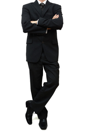 fine legs: fine businessman standing with legs and arms crossed Stock Photo