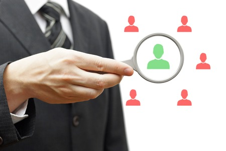 Choosing the right person for hiring in magnifying glass photo