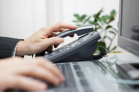remote communication: businessman is answering the phone