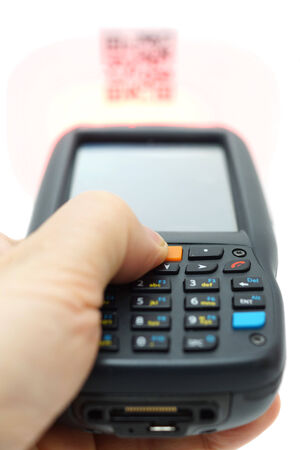 laser tag: scanning QR code label on the carton with laser isolated