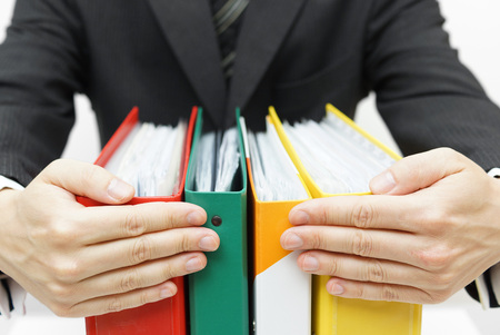 businessman holding binders at office Stock Photo