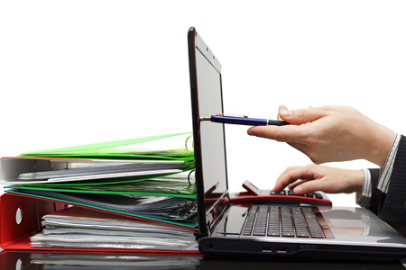 auditor pointing with pen on laptop screen, showing financial information photo
