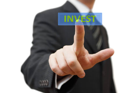 employee stock option: Businessman  touching virtual display with Invest word  Isolated