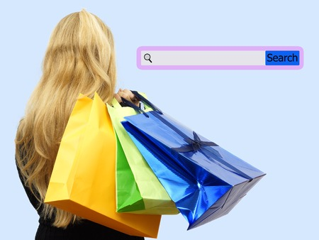 Girl holding shopping bags with search bar. Concept of internet shopping photo