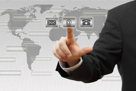 email us: Businessman pressing virtual   mail,phone,email   buttons  Contact us concept