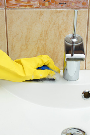 wipe: Cleaning sink in bathroom Stock Photo