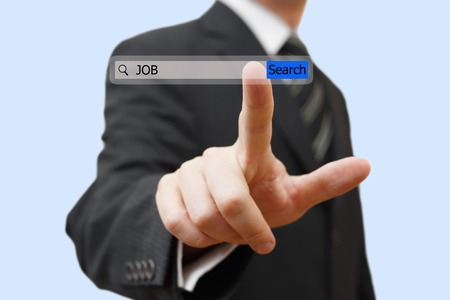 job hunt: Businessman touching an job search bar  Find job over internet concept
