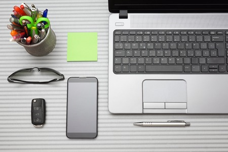 working space: modern office desk with working accessories, top view