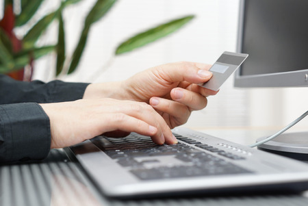 installment: Man is using credit card and computer for  on line payment  internet shopping concept