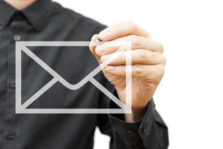 Man drawing email icon on virtual screen   Contact information concept