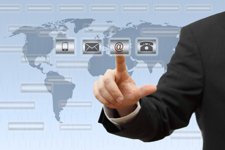 write us: Businessman pressing virtual   mail,phone,email   buttons  support concept