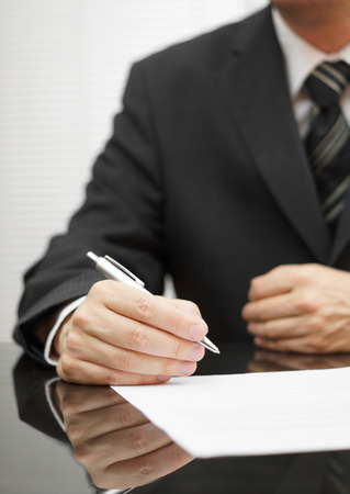 reconsider: businessman thinking about  a deal to sign Stock Photo