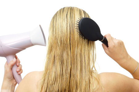 hair drier: Woman using hairdryer  and  comb