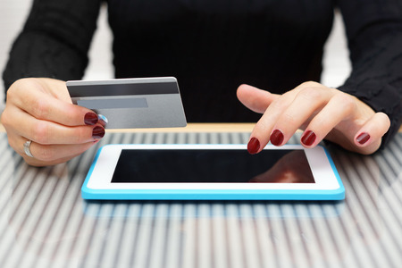 installment: woman is using credit card for on line shopping