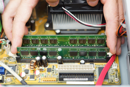 computer repair: Computer repair  Technician takes random access memory module out