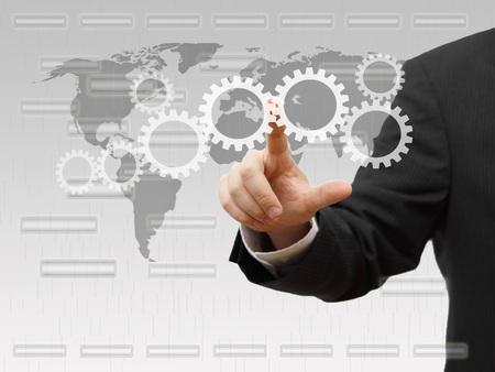 sprockets: Businessman pressing virtual sprockets  technology and innovation concept