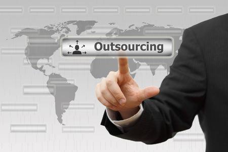 Outsourcing  Businessman pressing Outsourcing virtual button photo