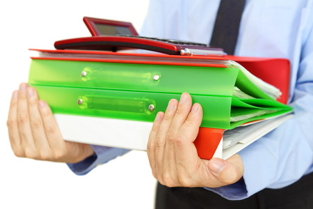 businessman carrying binders with documents and calculator photo