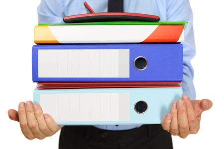 businessman carrying binders photo