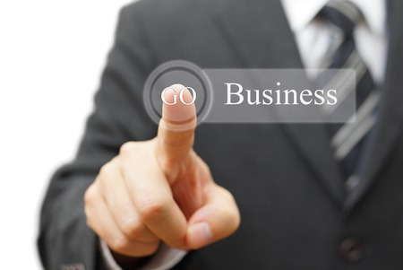 Businessman pressing  business  on virtual button, Business concept photo