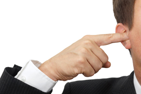 annoying: businessman blocking his ears with fingers   deaf manager concept Stock Photo