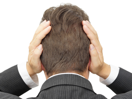unresponsive: businessman blocking his ears with hands Stock Photo