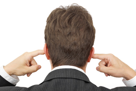 disobedient: businessman blocking his ears with fingers   deaf manager concept Stock Photo