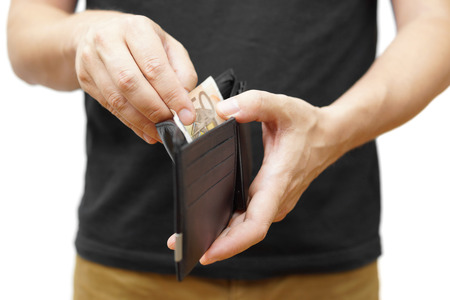 man hand holding a  wallet and taking money out