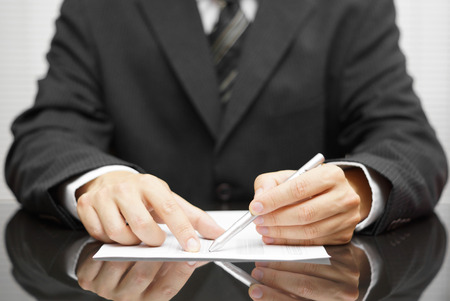 businessman pointing to mistake in report