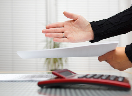 business partner is offering contract documentation to sign after successful negotiations photo