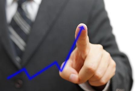 businessman touching growing arrow. Positive trend concept photo