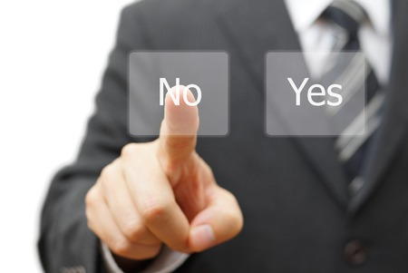 businessman choosing no instead yes button photo