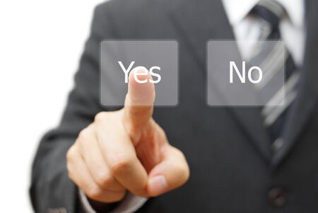 businessman pressing yes virtual button photo