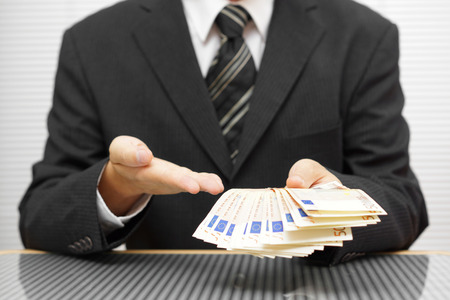 businessman shows that you take money and accept the deal. financial fraud and precaution concept