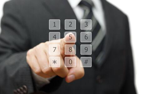 call: businessman is dialing on virtual telephone keypad Stock Photo