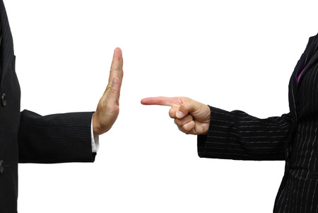 disobey: business woman pointing to coworker. He refuses task