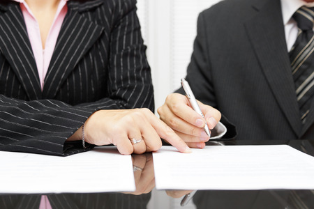 human settlement: business woman  show a businessman  to sign a agreement