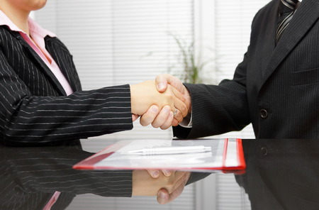 law report: Lawyer and client are handshaking after successful meeting