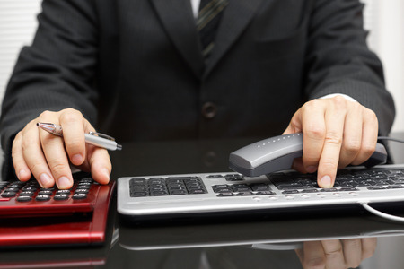 tax returns: consultant is working on computer and calling client