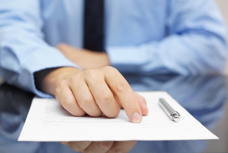 testimony: businessman show client where to sign Stock Photo